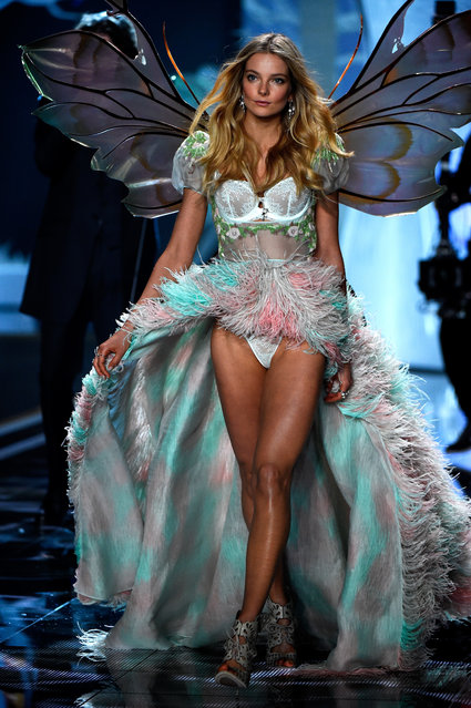 Model Eniko Mihalik walks the runway at the annual Victoria's Secret fashion show at Earls Court on December 2, 2014 in London, England. (Photo by Pascal Le Segretain/Getty Images)