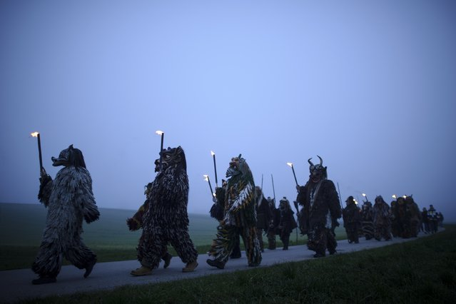 Participants dressed as Perchten roam village streets to chase away evil winter spirits in the annual Perchten gathering in Bavaria on November 29, 2014 near Kirchseeon, Germany. Perchten are the mythical entourage of Perchta, a goddess in ancient southern German alpine pagan tradition, and are usually fearsome creatures with tusks and horns and covered in hair. (Photo by Philipp Guelland/Getty Images)