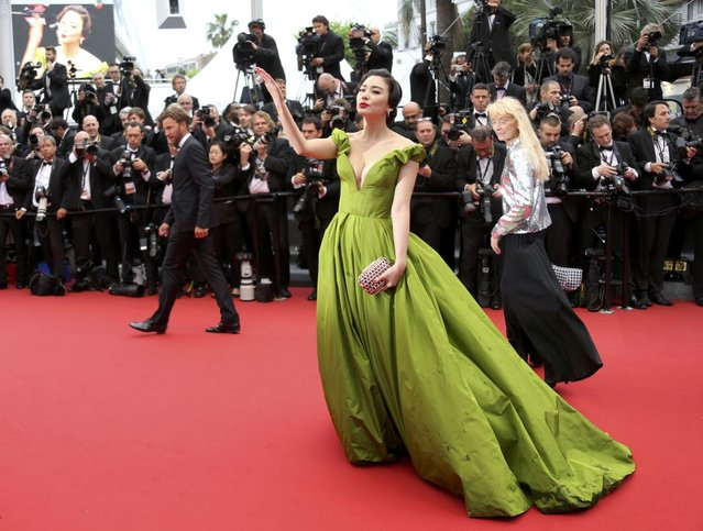 """Actress Zhang Yuqi poses on the red carpet as she arrives for the screening of the film """"The Great Gatsby"""" and for the opening ceremony of the 66th Cannes Film Festival in Cannes May 15, 2013. The Cannes Film Festival runs from May 15 to May 26. (Photo by Regis Duvignau/Reuters)"""