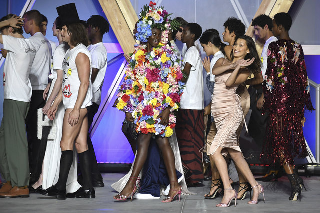 Model Bella Hadid, right, walks the runway with other models at the end of the Fashion For Relief 2018 event during the 71st international film festival, Cannes, southern France, Sunday, May 13, 2018. (Photo by Arthur Mola/Invision/AP Photo)