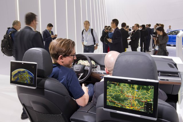 A display shows the Audi Tablet system during the 2015 International Consumer Electronics Show (CES) in Las Vegas, Nevada January 6, 2015. With the tablet, backseat passengers can send navigation instructions to the driver. (Photo by Steve Marcus/Reuters)