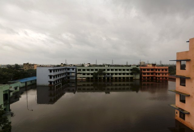A partially submerged government school building is pictured in a flooded area in Chennai, India, December 5, 2015. (Photo by Anindito Mukherjee/Reuters)