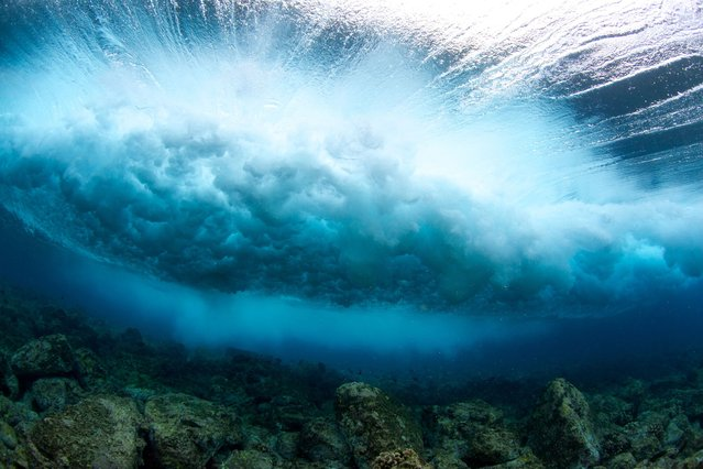 These incredible images capture the immense detail of waves beautifully crashing into the serene waters of Hawaii. (Photo by Bryce Groark/Caters)
