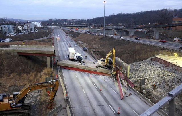 An early morning look of the aftermath of the bridge collapse on Interstate 75, Tuesday, Jan. 20, 2015 in Cincinnati, Ohio. The collapse killed a worker and injured a truck driver. The Ohio Department of Transportation said the busy artery through downtown Cincinnati will be closed at least two to three days. (AP Photo/The Enquirer, Liz Dufour)