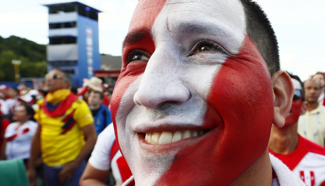A Peru's fan cheers prior to the Russia 2018 World Cup Group C football match between France and Peru at the Ekaterinburg Arena in Ekaterinburg on June 21, 2018. (Photo by Gleb Garanich/Reuters)