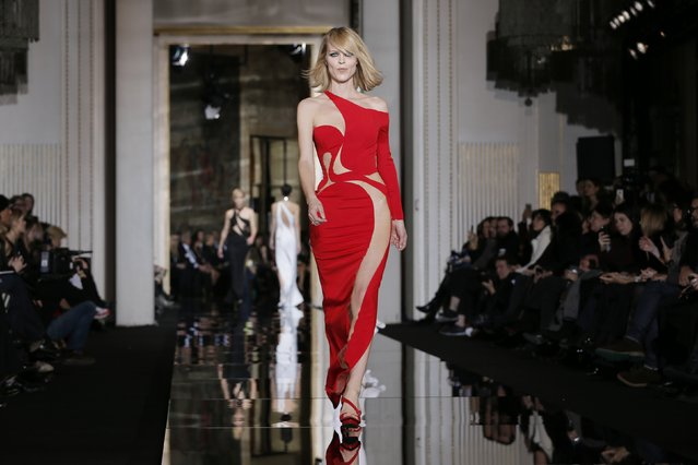 Model Eva Herzigova of the Czech Republic presents a creation by Italian designer Donatella Versace as part of her Haute Couture Spring Summer 2015 fashion show in Paris January 25, 2015. (Photo by Gonzalo Fuentes/Reuters)