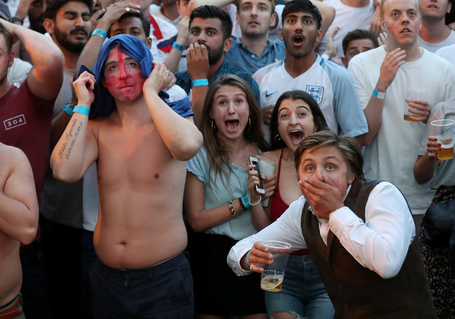 England fans react in frustration after Colombia scored to make it 1-1, as they watch on a big screen the round of 16 match between England and Colombia at the 2018 soccer World Cup, in Flat Iron Square, south London, Tuesday, July 3, 2018. (Photo by Simon Dawson/Reuters)