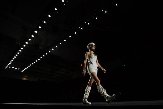 A model displays an Autumn/Winter design by Maya Hansen at Madrid's Fashion Week  in Madrid, Spain, Tuesday, Feb. 10, 2015 . (AP Photo/Daniel Ochoa de Olza)