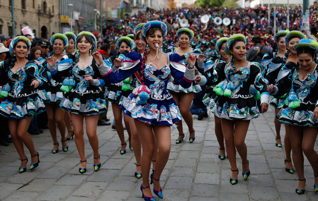 Women dance Caporal during the carnival in La Paz, Bolivia, Saturday, February 7, 2015. The Caporal dancers accompany fellow carnival characters Chuta, Pepino and Chola who represent gaiety and never tire of dancing. (Photo by Juan Karita/AP Photo)