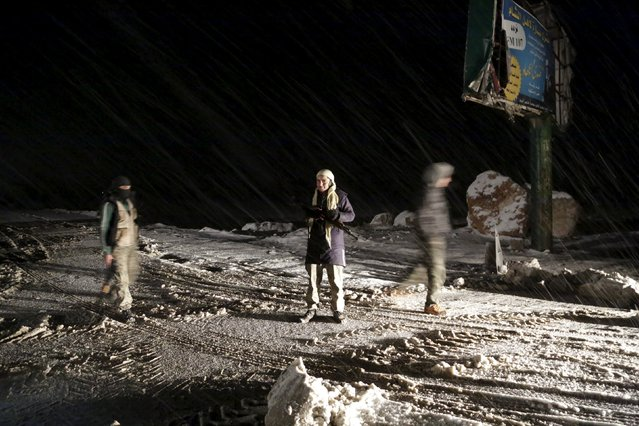 Free Syrian Army fighters stand at a checkpoint on a highway linking Aleppo with the capital Damascus, during a snow storm in Idlib province, Syria January 4, 2016. (Photo by Khalil Ashawi/Reuters)