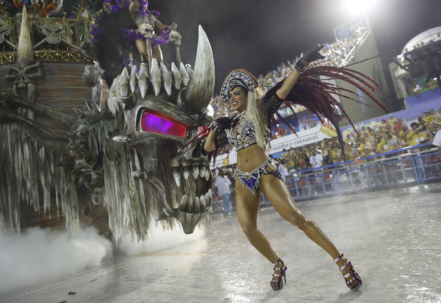 A performer from the Vila Isabel samba school parades during carnival celebrations at the Sambadrome in Rio de Janeiro, Brazil, Monday, February 16, 2015. (Photo by Leo Correa/AP Photo)