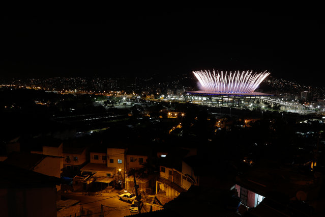 The Maracana Olympic Stadium during the opening ceremony is seen from the Mangueira favela slum during the Rio Olympic Opening Ceremony August 5, 2016. (Photo by Ricardo Moraes/Reuters)