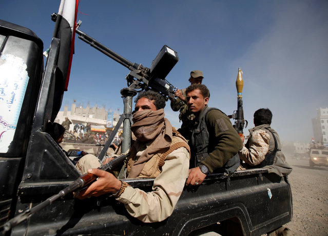 Houthi fighters ride on the back of a truck during a tribal gathering held to mobilize fighters for the battles against government forces, in Sanaa, Yemen November 24, 2016. (Photo by Khaled Abdullah/Reuters)
