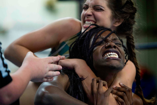 Professional wrestler Gia Scott (R) tries to break free from the grip of professional wrestler Aria Palmer (L) during Autumn Armageddon 2018 in Galena, Maryland on October 6, 2018. (Photo by Jim Watson/AFP Photo)