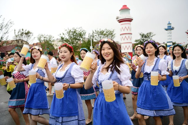 The 31st Qingdao International Beer Festival held an opening ceremony at the Golden Beach Beer City in Qingdao city, east China's Shandong province on July 16, 2021. (Photo by Rex Features/Shutterstock)