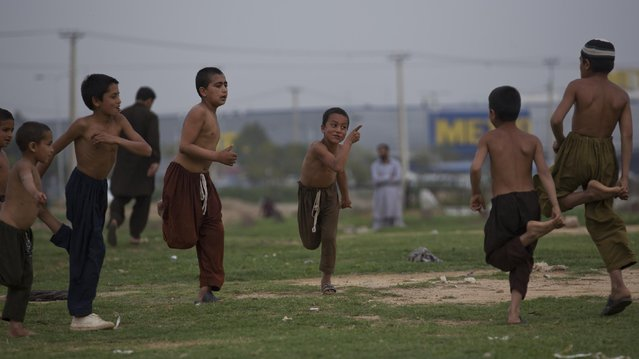 Pakistani children, who are displaced from tribal areas where security forces are currently fighting against militants, play in Islamabad's slums, Friday, March 27, 2015 in Pakistan. (Photo by B. K. Bangash/AP Photo)