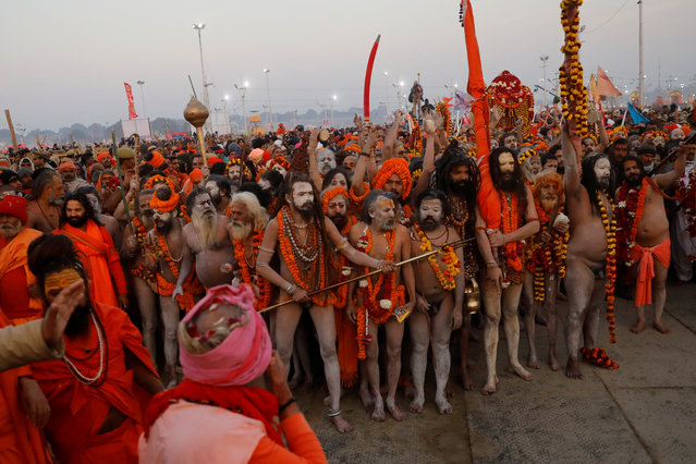 """Naga Sadhus or Hindu holy men arrive to take a dip during the first """"Shahi Snan"""" (grand bath) at """"Kumbh Mela"""" or the Pitcher Festival, in Prayagraj, previously known as Allahabad, India, January 15, 2019. (Photo by Danish Siddiqui/Reuters)"""