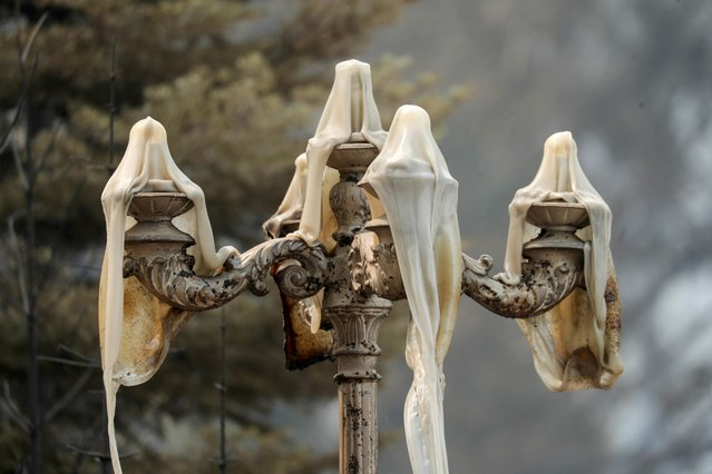 Melted outdoor lighting is seen in Greenville, California, U.S., August 10, 2021. (Photo by David Swanson/Reuters)
