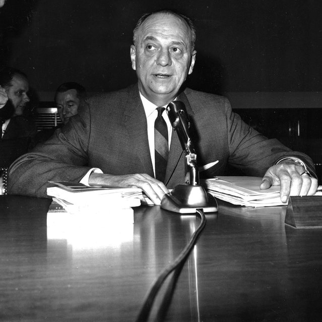 In this April 9, 1965 file photo, Luther Terry, surgeon general of the U.S., testifies in Washington before the House Commerce Committee on proposed labeling of cigarette packages. On January 11, 1964, Terry released an emphatic and authoritative report that said smoking causes illness and death – and the government should do something about it. (Photo by AP Photo)