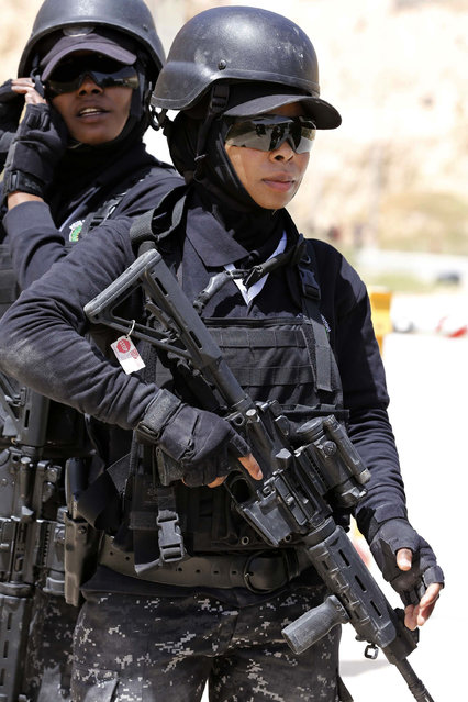 Members of the Jordanian women's police special operations team compete during the 7th Annual International Warrior Competition hosted by the King Abdullah Special Operations Training Center (KASOTC), in Amman, Jordan, Tuesday, April 21, 2015. (Photo by Raad Adayleh/AP Photo)