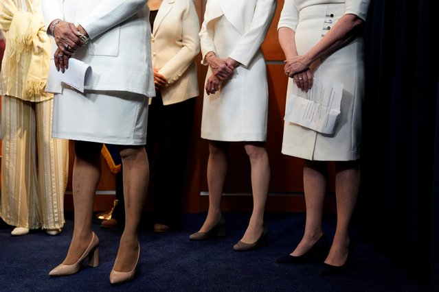 Democratic women House members stand during a briefing with the media recognizing suffragettes before the State of Union address on Capitol Hill in Washington, U.S., February 5, 2019. The lawmakers were dressed elegantly in white to celebrate 100 years of women having the right to vote. (Photo by Joshua Roberts/Reuters)