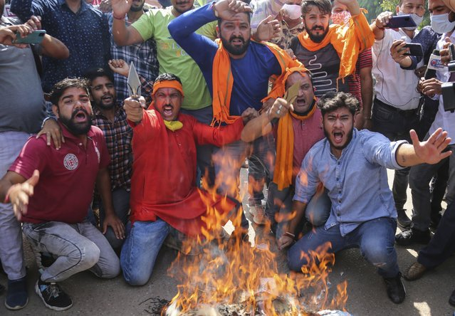 Activists of Rashtriya Bajrang Dal protesting against Tuesday's killing of three men in Indian-controlled Kashmir shout slogans and burn an effigy of Pakistan in Jammu, India, Wednesday, October 6, 2021. Police has blaming militants fighting against Indian rule in the disputed region for the string of targeted attacks. (Photo by Channi Anand/AP Photo)