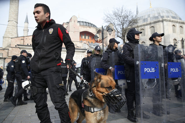 Backdropped by the Byzantine-era Hagia Sophia, Turkish police officers provide security during a protest against the mosque attacks in New Zealand in Istanbul, Saturday, March 16, 2019. World leaders expressed condolences and condemnation following the deadly attacks on mosques in the New Zealand city of Christchurch, while Muslim leaders said the mass shooting was evidence of a rising tide of violent anti-Islam sentiment. (Photo by Lefteris Pitarakis/AP Photo)