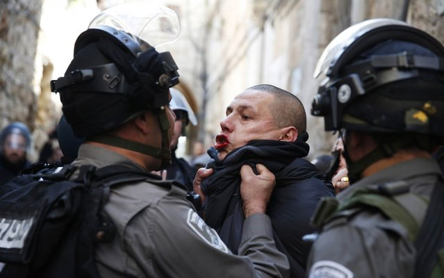 An Israeli policeman scuffles with a Palestinian during clashes near Lion's Gate in Jerusalem's Old City February 7, 2014. Tensions briefly ran high on Friday in Jerusalem's Old City following clashes that erupted between Israeli police and stone-throwing Palestinians on a compound known to Muslims as Noble Sanctuary and to Jews as Temple Mount. (Photo by Darren Whiteside/Reuters)