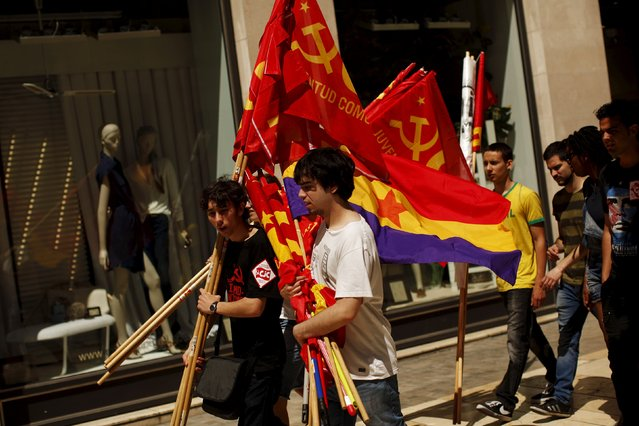 People carry a second Spanish Republic flag (R) and Communist flags after a May Day rally in Malaga, Spain May 1, 2015. (Photo by Jon Nazca/Reuters)