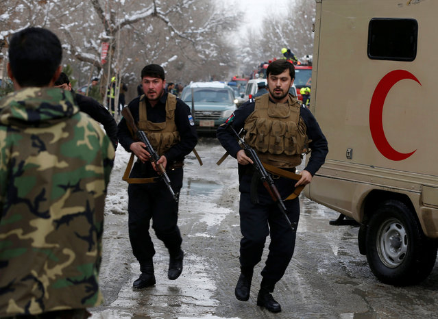 Afghan policemen arrive at the site of a bomb blast in Kabul, Afghanistan February 7, 2017. (Photo by Omar Sobhani/Reuters)