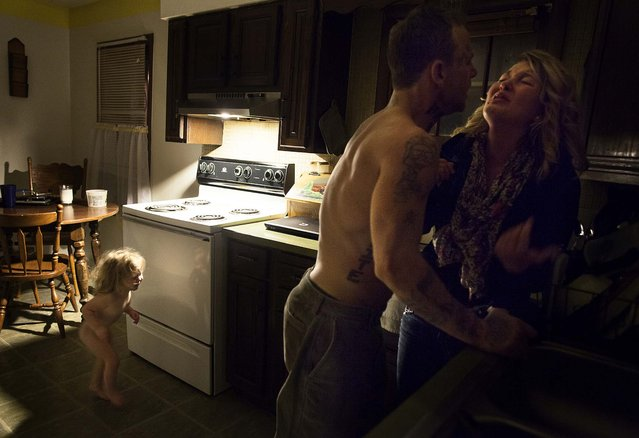 1st prize in the Contemporary Issues Stories category. Sara Naomi Lewkowicz, USA, for Time. As the fight continued to rage, Shane told Maggie that she could choose between getting beaten in the kitchen, or going with him to the basement so they could talk privately, in Lancaster, Ohio. (Photo by Sara Naomi Lewkowicz/World Press Photo)