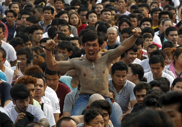 A devotee in a state of trance mimic creatures tattooed on his bodies during the annual Magic Tattoo Festival at Wat Bang Phra in Nakhon Pathom province, on the outskirts of Bangkok, Thailand March 19, 2016. (Photo by Chaiwat Subprasom/Reuters)