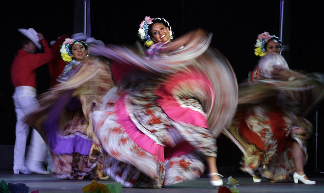 Dancers perform during Cinco de Mayo celebrations in Portland, Ore., Tuesday, May 5, 2015. (Photo by Don Ryan/AP Photo)