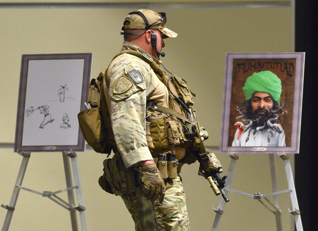 Heavily armed police secure art work before the Dutch member of parliament and leader of the far-right Party for Freedom, Geert Wilders delivers the keynote address at the Muhammad Art Exhibit and Contest at the Curtis Culwell Center in Garland, Texas, USA, 03 May 2015. The art exhibit is being put on by the Pamela Geller's American Freedom Defense Initiative. (Photo by Larry W. Smith/EPA)