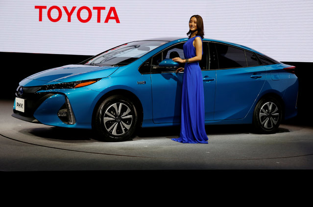 Japanese actress Satomi Ishihara poses next to Toyota Motor Corp.' Prius PHV Plug-in-Hybrid vehicle, also known as Prius Prime in the U.S., during an event to mark the launch of the car in Japan, in Tokyo, Japan February 15, 2017. (Photo by Issei Kato/Reuters)
