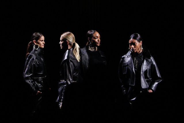 Models wear creations for Balmain's ready-to-wear fall/winter 2014-2015 fashion collection, presented in Paris, Thursday, Feb.27, 2014. (Photo by Thibault Camus/AP Photo)