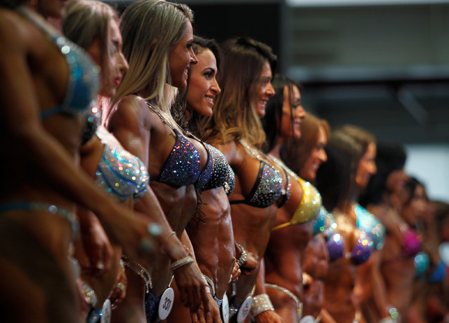 Women participate during the Mr. Olympia Amateur South America bodybuilding competition in Medellin, Colombia, February 19, 2017. (Photo by Fredy Builes/Reuters)