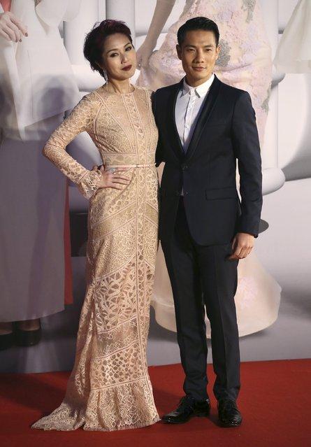 Hong Kong actress Miriam Yeung and husband Real Ting pose on the red carpet at the Hong Kong Film Awards in Hong Kong, China April 3, 2016. (Photo by Reuters/Stringer)