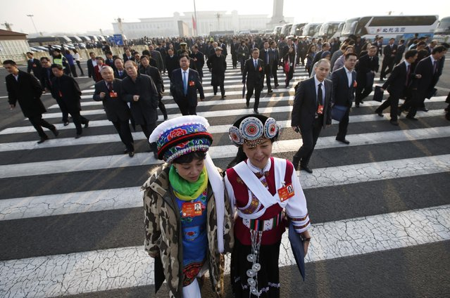 Ethnic minority delegates arrive at the Great Hall of the People prior to a plenary session of the National People's Congress (NPC) in Beijing March 9, 2014. (Photo by Kim Kyung-Hoon/Reuters)