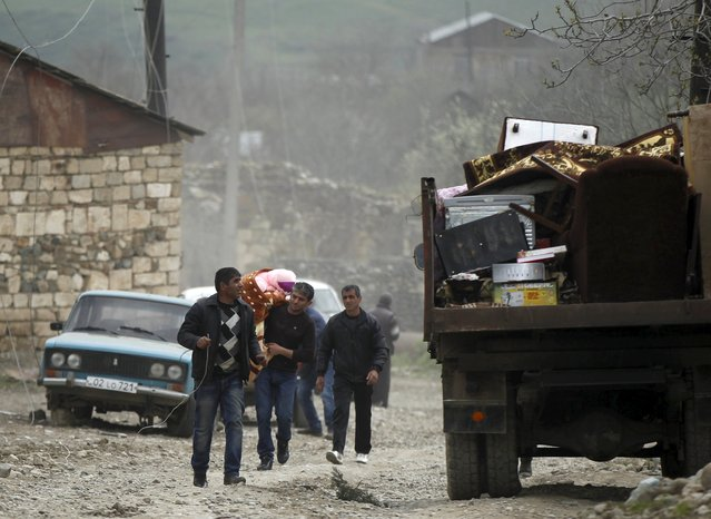 Local residents carry their belongings as they flee from the Nagorno-Karabakh's village of Talish April 6, 2016. (Photo by Reuters/Staff)