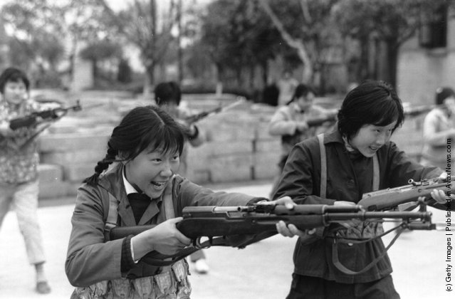 1973: In Maoist China, Shanghai girls are taught how to kill with bayonetted rifles, demonstrated here in an exercise drill