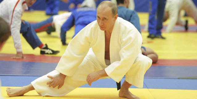 Russian Prime Minister Vladimir Putin attending a judo training session at St. Petersburg's Moskovsky sports and recreation center, 2010. (Photo by Alexei Druzhinin/AFP Photo/RIA Novosti)