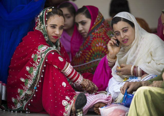 Sikh pilgrims attend a religious festival in Hasan Abdal near Islamabad in Pakistan, Tuesday, April 14, 2015. Pilgrims arrived from neighboring India and other countries to attend the religious festival 'Besakhi' at a shrine of Gurdwara Punja Sahib, the second most sacred place for Sikhs. (Photo by B. K. Bangash/AP Photo)
