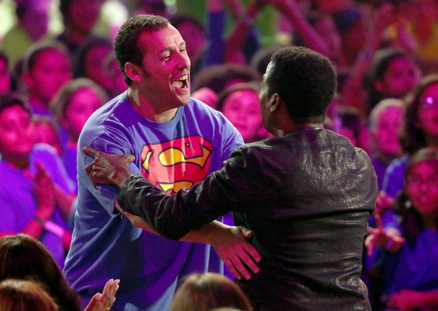 Adam Sandler accepts the award for favorite movie actor at the 27th annual Kids' Choice Awards at the Galen Center on Saturday, March 29, 2014, in Los Angeles. (Photo by Matt Sayles/Invision/AP Photo)