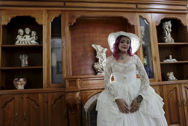 "Adriana Barahona, known as "" Madame Barocle,"" poses in clothing of the Victorian era at her house in Heredia, Costa Rica June 4, 2015. Barahona says she has been passionate about clothing from the era of Britain's Queen Victoria (1837-1901), and has been making and wearing them since the age of 15. REUTERS/Juan Carlos Ulate"