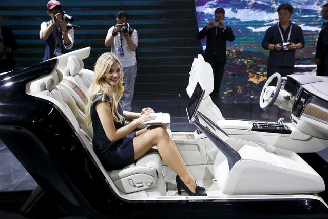 A girl types on a computer as she demonstrates the interior of the new Volvo S90 during the Auto China 2016 auto show in Beijing April 25, 2016. (Photo by Damir Sagolj/Reuters)