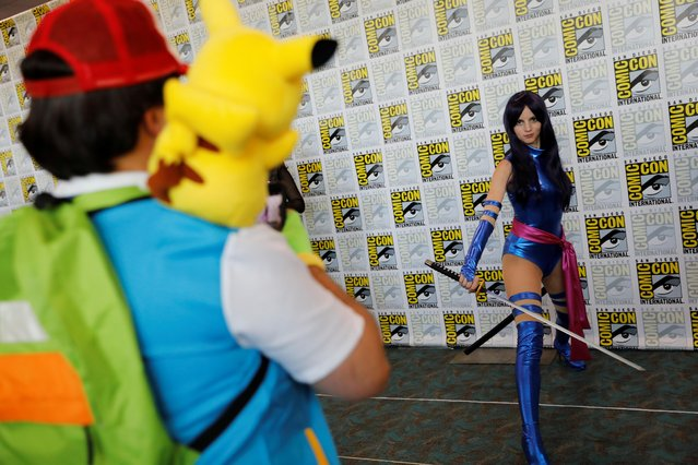 An attendee poses for a picture as they arrive in a costume to enjoy Comic Con International in San Diego, California, U.S., July 19, 2019. (Photo by Mike Blake/Reuters)