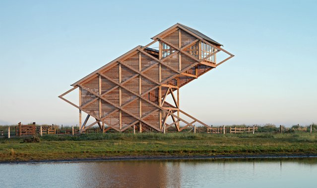 Bird observation tower, Heiligenhafen , Germany, by Gerkan, Marg und Partner. Located in the Graswarder nature reserve on Germany's northern Baltic coast, this avian-shaped tower comes complete with a viewing room 15 metres up in the sky. (Photo by Heiner Leiska/The Guardian)