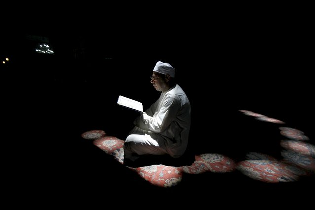 A Muslim man reads the Koran during the holy month of Ramadan inside Al-Refaie mosque in the old Islamic area of Cairo, Egypt, June 28, 2015. (Photo by Mohamed Abd El Ghany/Reuters)