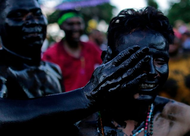 Catholic faithful smeared in burnt oil, take part in the opening of the ten-day celebration of the Santo Domingo de Guzman festival in Managua, on August 1, 2019. (Photo by Inti Ocon/AFP Photo)